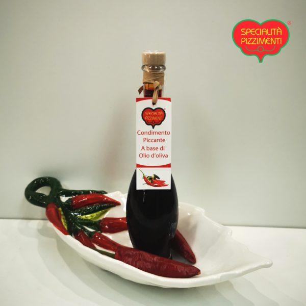 Condimento a base di olio di oliva aromatizzato al peperoncino piccante
